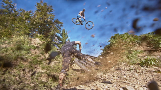 slo mo mtb bikers riding on a downhill trail - mountain biking stock videos & royalty-free footage