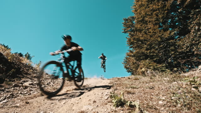 SLO MO Bikers riding on a downhill trail