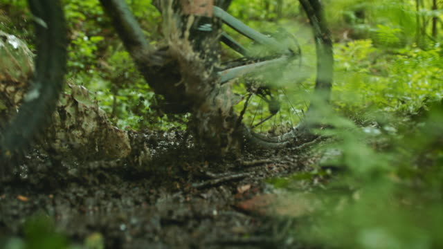 super slo mo mtb bikers riding through a mud - mud stock videos & royalty-free footage