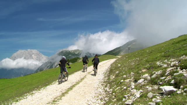 HD CRANE: Bikers Riding Up Mountain Road