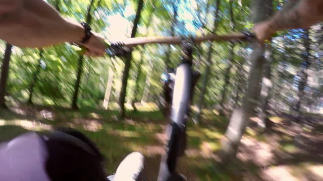 POV MTB bikers speeding through the forest