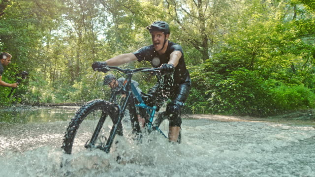 super slo mo time warp effect mtb bikers splashing through a stream - all horse riding stock videos & royalty-free footage