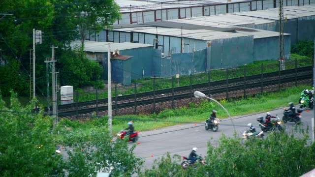 bikers train in urban district - telephoto lens stock videos and b-roll footage