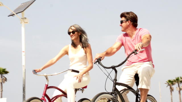bikes couple - wellbeing stock videos & royalty-free footage