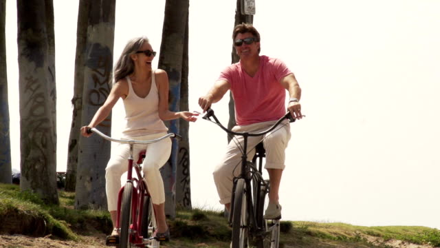 bikes couple - mature couple stock videos & royalty-free footage