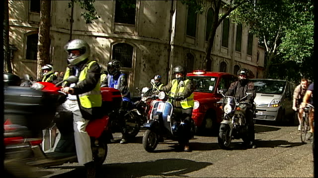 biking parking fee protestors at high court england london ext gvs protestors on bikes / motorcycles beeping horns as along during bike protest one... - fee stock videos & royalty-free footage