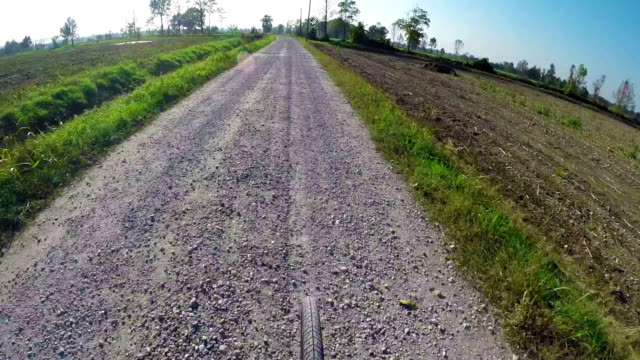 biking rider's perspective on country road - pjphoto69 stock videos & royalty-free footage