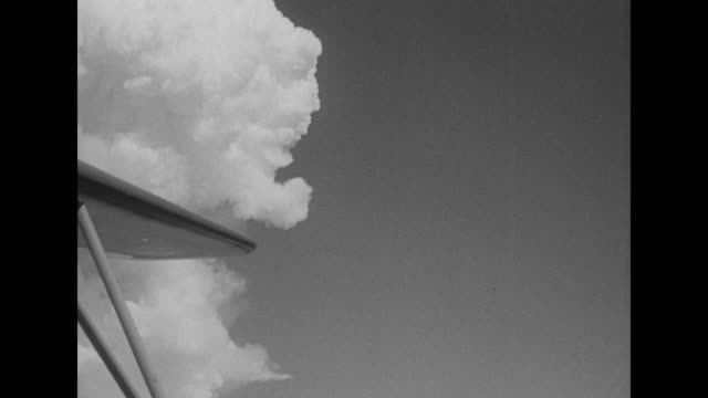 bikini atoll / mushroom cloud climbs in the sky / cu top of cloud forming / various angles of cloud / note exact day not known - bikini top stock videos & royalty-free footage