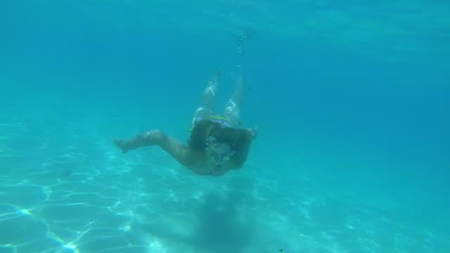bikini woman swimming underwater