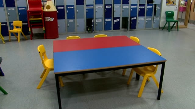 Bilingual Primary School in Brighton ENGLAND Sussex Brighton Bilingual Primary School INT Empty chairs and table in classroom with lockers in...
