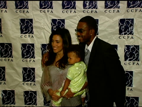bill and kristen bellamy with daughter at the 6th annual lullabies and luxuries luncheon and fashion show to benefit caring for children and families... - bill bellamy stock videos and b-roll footage
