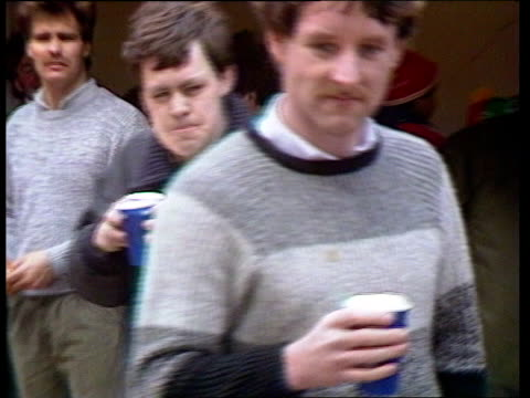 bill approved to ban alcohol at football grounds itn merseyside anfield road drink in paper cup held pull out to anfield rd youth towards carrying... - forbidden stock videos & royalty-free footage