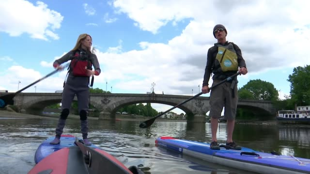 bill bailey joins volunteers to clear up the thames near kew england london kew bridge ext pile of paddleboards on riverbank people paddleboarding... - oar stock videos & royalty-free footage