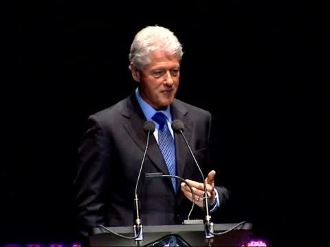 vídeos de stock, filmes e b-roll de bill clinton delivering royal albert hall speech why did hamas win the palestinian elections / people voted for them because they thought they were... - bill clinton
