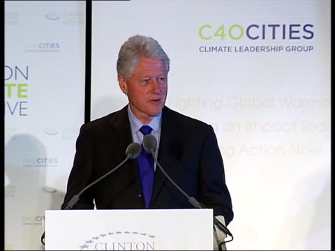 bill clinton public buildings to go green speech; usa: new york: int bill clinton along to podium as followed by mayor of london ken livingstone and... - percentage sign stock videos & royalty-free footage
