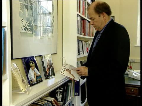 monica lewinsky tapes released:; england: london: int side michael o'mara along to pick up 'diana, her true story' book from display on bookcase... - bookshelf stock videos & royalty-free footage