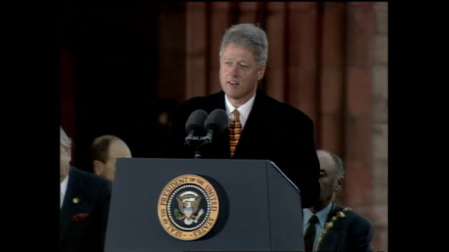 bill clinton speak to crowd in square from podium and bill shaking hands with david trimble then leaves stage on november 30 1995 in londonderry... - bill clinton stock videos and b-roll footage