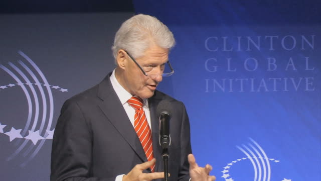 vídeos y material grabado en eventos de stock de ms bill clinton speaking into microphone at podium during annual clinton global initiative / new york city new york usa / audio - sólo hombres maduros