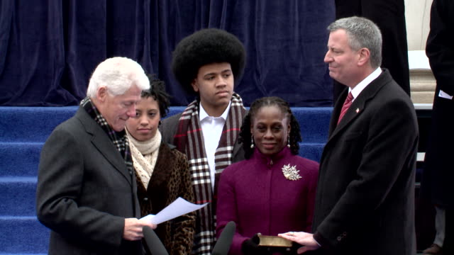 bill clinton speaks before ceremonially swearing in bill de blasio as mayor of new york city on january 1, 2014. - produced segment stock videos & royalty-free footage