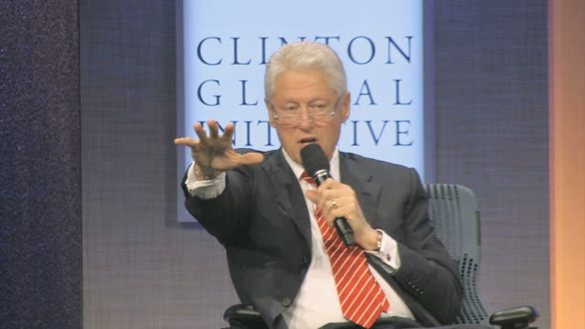 vídeos y material grabado en eventos de stock de ms bill clinton talking and gesturing on microphone during annual clinton global initiative / new york city new york usa / audio - sólo hombres maduros