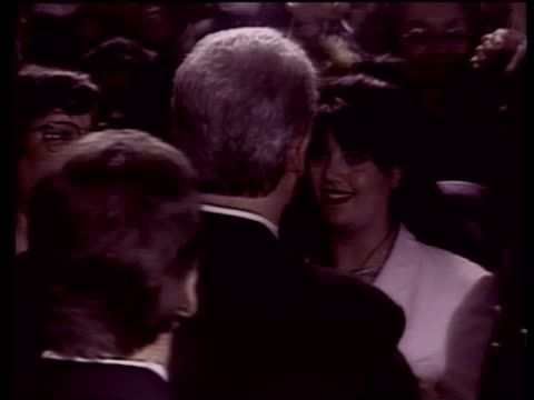 bill clinton walks through crowd hugging and shaking hands stops to hug monica lewinsky 1998 - bill clinton stock videos & royalty-free footage