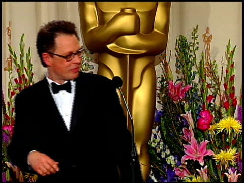 bill condon at the 1999 academy awards at the shrine auditorium in los angeles, california on march 21, 1999. - 第71回アカデミー賞点の映像素材/bロール