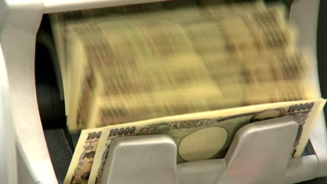 Bill counting machine counting ten thousand yen bills