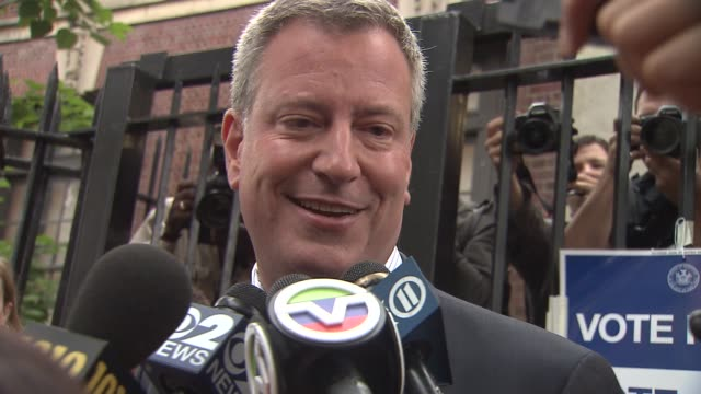 bill de blasio and wife chirlane mccray vote on mayoral primary election day de blasio to undecided voters'i'm your candidate' on september 10 2013... - mixed race person stock videos & royalty-free footage