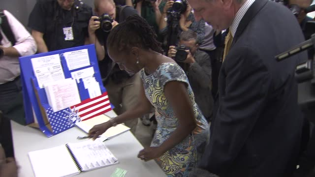 bill de blasio and wife chirlane mccray vote on mayoral primary election day chirlane mccray writes signature and votes on september 10 2013 in... - mixed race person stock videos & royalty-free footage