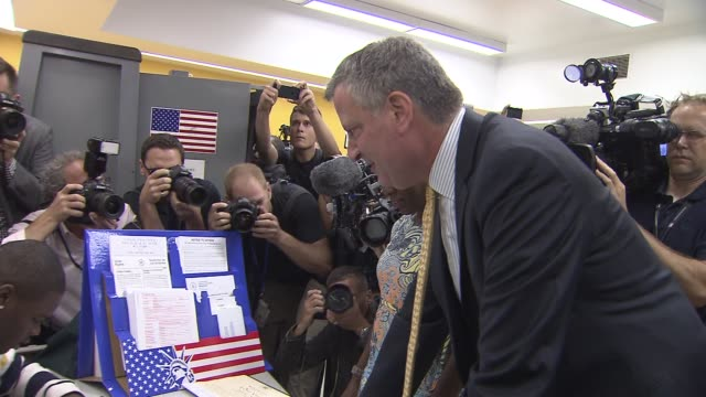 bill de blasio and wife chirlane mccray vote on mayoral primary election day bill de blasio gives signature at voting station on september 10 2013 in... - mixed race person stock videos & royalty-free footage