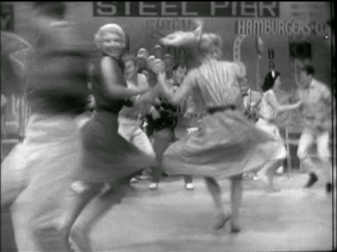 "b/w 1956 bill haley + comets perform ""hot dog buddy buddy"" / dancers swing in foreground / atlantic city - 1950 stock-videos und b-roll-filmmaterial"
