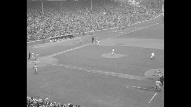 Bill Lee Chicago Cubs pitcher pitches from mound / Lou Gehrig New York Yankees at bat walks camera follows him to first base / close up Bill Dickey...