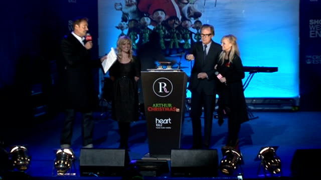 bill nighy and ashley jensen turn on regent street christmas lights; bill nighy and ashley jensen introduced & onto stage / ashley jensen describing... - nutshell stock videos & royalty-free footage