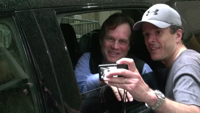 bill paxton signs for and poses with fans from his car outside live with kelly, 5-24-12 bill paxton signs for and poses with fans from his on may 24,... - bill paxton stock videos & royalty-free footage