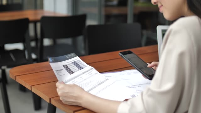 bill payment with mobile phone - electronic banking stock videos & royalty-free footage