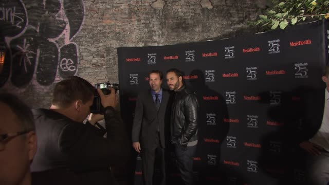 Bill Phillips and Daniel Sunjata at Men's Health Celebrates 25th Anniversary at Isola Mondrian Soho Hotel on October 09 2013 in New York New York