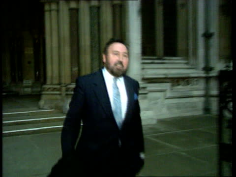 london high court ms ken irwin towards out of court and stops for photographers - ウィリアム・ローチ点の映像素材/bロール