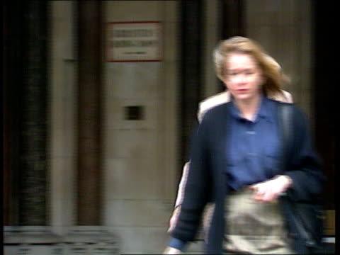 bill roache case ms sara roache out of court and along pan rl - ウィリアム・ローチ点の映像素材/bロール