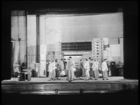vidéos et rushes de bill robinson dancing on stage with chorus line of women behind him / feature - art du spectacle