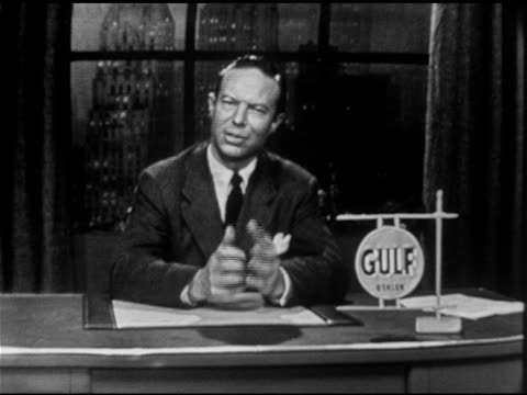 Bill Rogers sitting at desk on set w/ Gulf logo sign on desktop SOT saying have to remember to make opinions count free choice Bill placing model of...