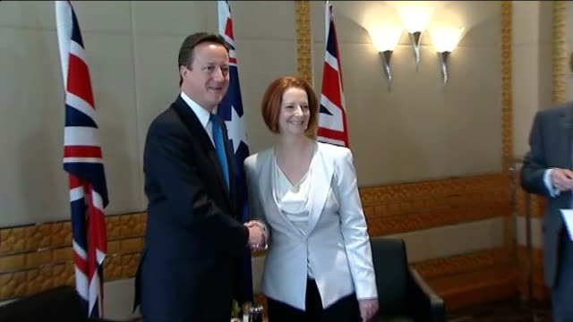 bill shorten supports views of prime minister in tv interview; r29101104 perth: david cameron mp shaking hands with julia gillard at commonwealth... - premierminister stock-videos und b-roll-filmmaterial