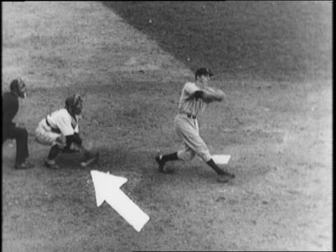 Bill Slater talking / cameraman filming / Bill Dickey gets a hit off Dodger pitcher Whitlow Wyatt Charlie Keller goes to 3rd / Wyatt pitches wild...