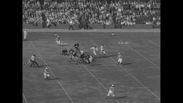 bill stribling runs for the new york giants during football game against the washington redskins at griffith stadium / slo-mo giants kick off to... - アメフト ファーストダウン点の映像素材/bロール