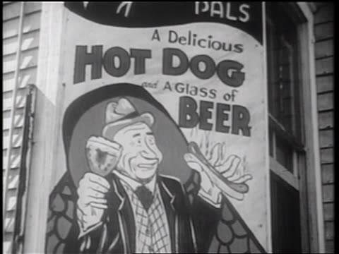 """b/w 1939 billboard advertising """"a delicious hot dog and a glass of beer"""" / documentary - commercial sign stock videos and b-roll footage"""