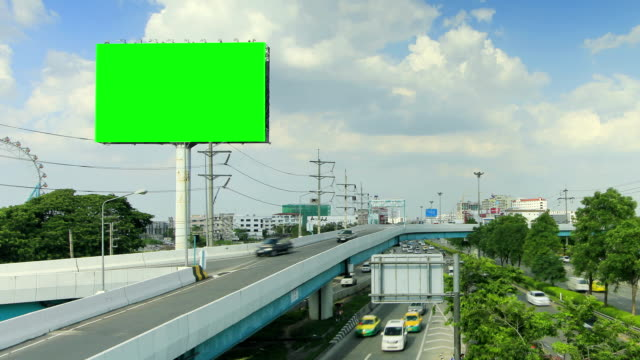 vídeos de stock e filmes b-roll de outdoor e estrada com movimento de nuvens, time lapse - billboard