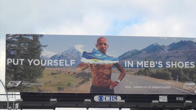 stockvideo's en b-roll-footage met billboard featuring meb keflezighi boston and nyc marathon winners outside javits center 34th and 12th ave skechers performance - salmini