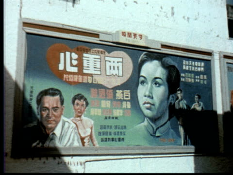 vídeos de stock, filmes e b-roll de 1957 montage billboard for chinese movie in chinese. billboard for indian film rukh sana in english. billboard for malayan film selamat tinggal kekasehku. / singapore / audio - língua chinesa
