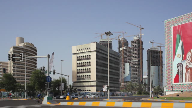 WS PAN Billboard in city, traffic on road / Abu Dhabi, United Arab Emirates