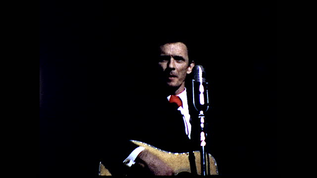 """billboard in front of krnt theatre """"grand ole opry stonemans dave dudley wed. jan. 1-3 &8""""; man in different suits singing with guitar on stage under... - 1960 1969 stock videos & royalty-free footage"""
