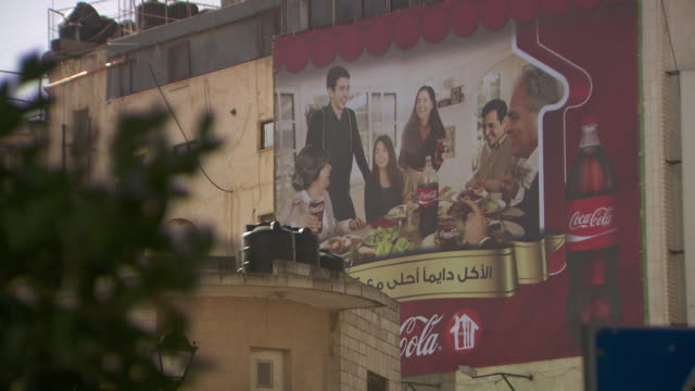 a billboard in ramallah in the west bank advertises cocacola - ramallah stock videos and b-roll footage